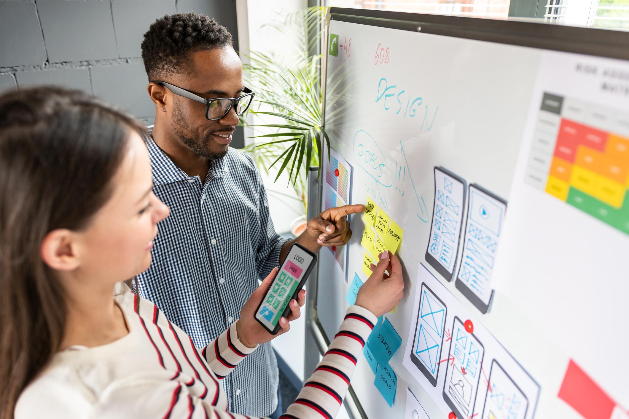Marketing-team-reviewing-their-company's-brand-evolution-needs