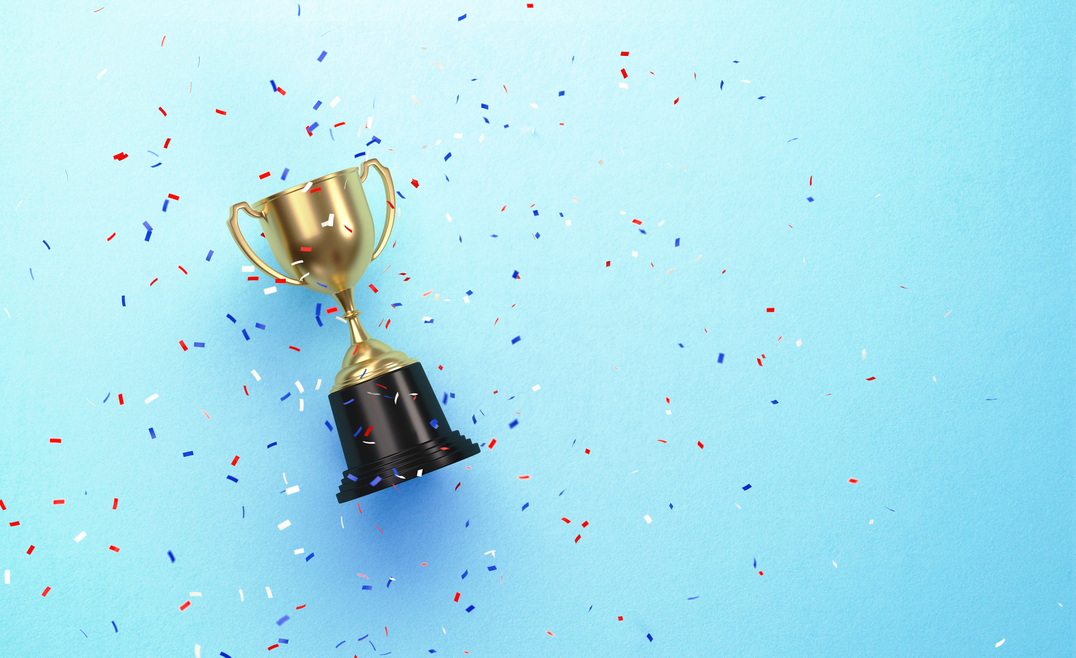 Image depicting a gold cup with confetti falling on a blue background to symbolize winning at customer service in a post-pandemic world.